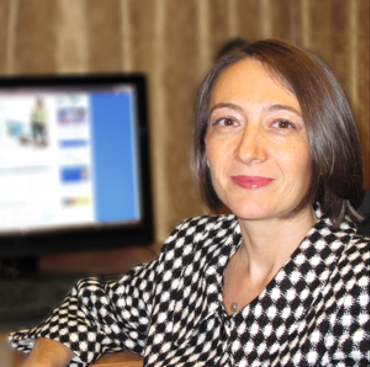 Dr Corina Mella